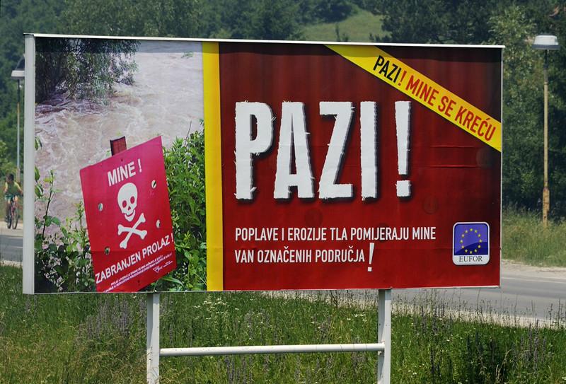 Billboard warning of land mines, Duboki Potok, Bosnia-Hercegovina, Tues 10 June 2014.