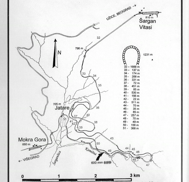 Map of the Sargan 8 Mountain Railway, Serbia.  The direct distance from Mokra Gora to Sargan Vitasi is only about 4km, but the height difference is 250m.  This map shows the 16.33km (10 mile) route devised by Yugoslav engineeers to keep gradients manageable.  The average is 1.53% (i in 64), the steepest is 1.922% (1 in 52).  The figure of 8 traced by the line is clearly visible, as are the 20 tunnels.  The Mokra Gora - Sargan Vitasi section used to take about 35 minutes in steam days.  Eastbound trains were usually double-headed by a combination of class 83 0-8-2 or class 85 2-8-2.  The pilot loco would be detached at Sargan Vitasi, turned on the triangle, and returned light engine to Visegrad.