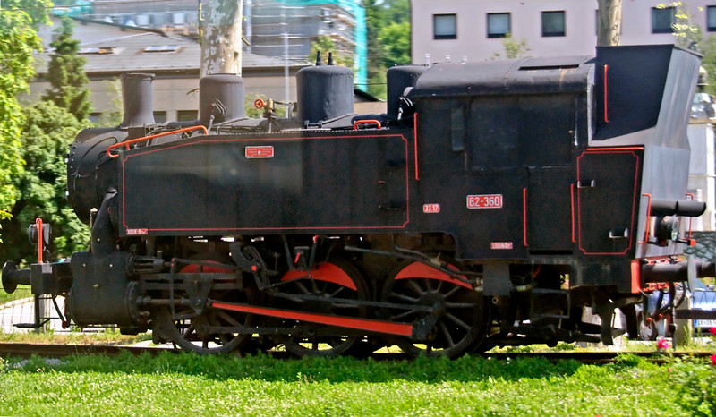 62-360, Sevnica, Slovenia, 23 May 2009.  Yugoslav copy of the well-known US Army Transportation Corps 0-6-0T of World War 2, of which 106 found their way to Yugoslavia.  More were built in Slavonski Brod by Djuro Djakovic, 23 for Yugoslav Rlys and an unknown number for industrial lines.  62-360 was one of the latter (DD 360 / 1953).  (Photographed from inside a Ljubljana - Belgrade train.)
