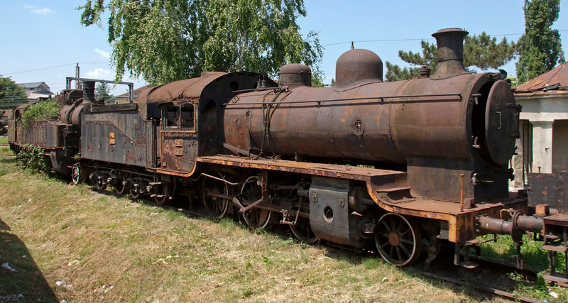 Yugoslav Rlys (JZ) 20-100, Nis, Serbia, 25 May 2009.  A 2-6-0 built by Henschel (19093 / 1922), one of 200 of the class built in Germany after the First World War as reparations. 17.035 is visible at left.  Photographed from a Belgrade - Sofia train.