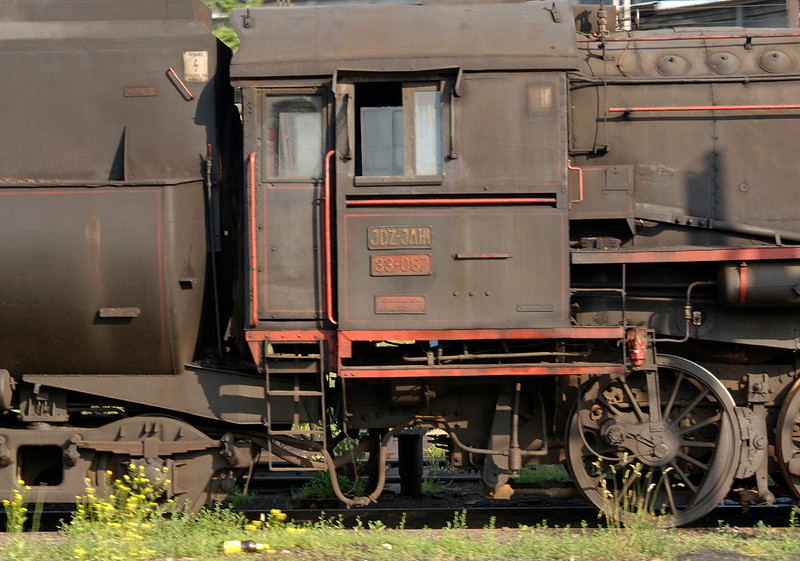 Yugoslav State Rlys (JDZ) 33-087, outside Belgrade station, Serbia, 25 May 2009 2.  The Kriegslok still has its Henschel builder's plate (28366 / 1944)  below its number plate.  It has been operational in recent years, but NB that there is no coupling rod to the rear axle.