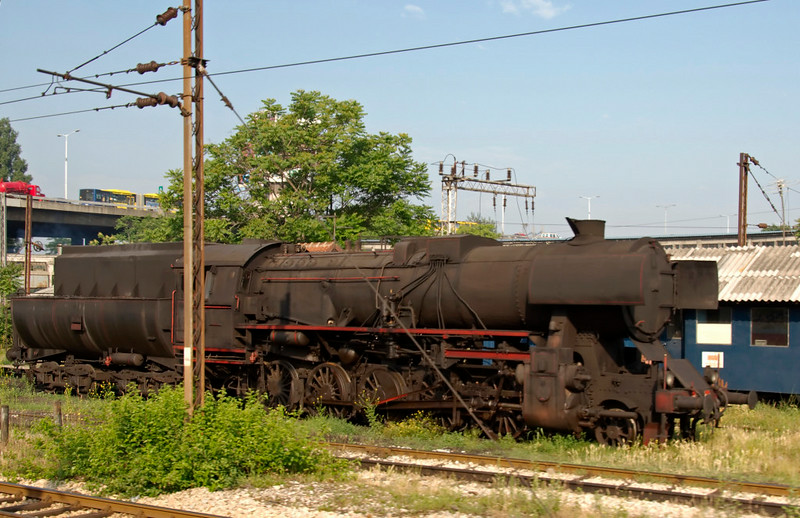 Yugoslav State Rlys (JDZ) 33-087, outside Belgrade station, Serbia, 25 May 2009 1.  The Kriegslok was originally DRG 52.2802.  Photographed from a Belgrade - Sofia train.