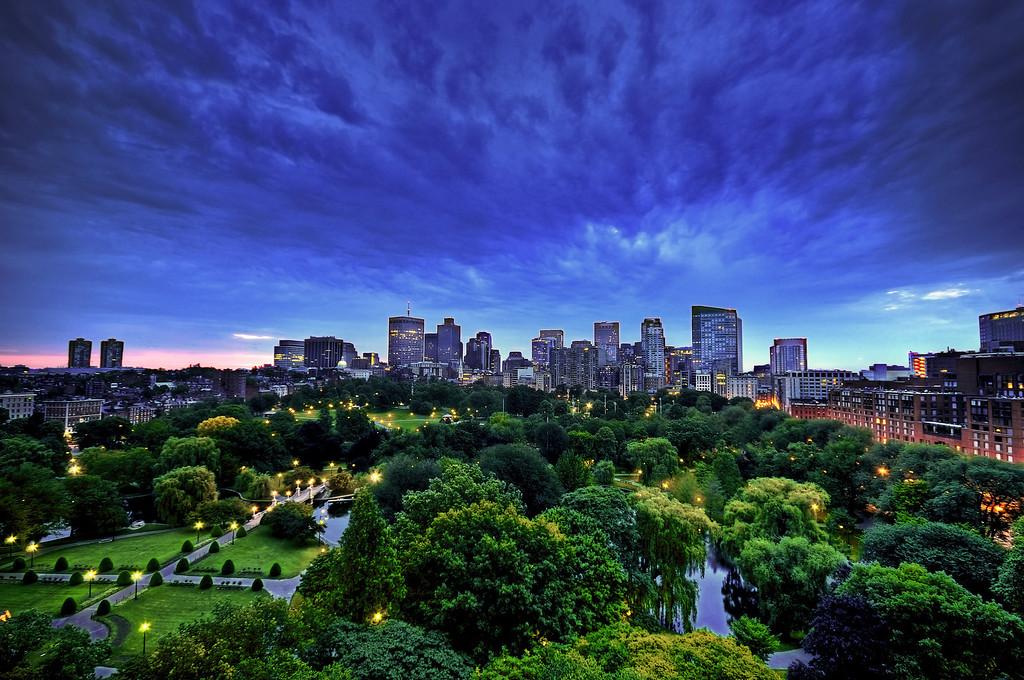 Boston skyline and Boston Public Garden before sunrise.
