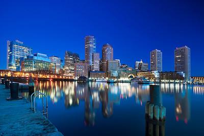 Reflection of downtown Boston at Harbor, Massachusetts.