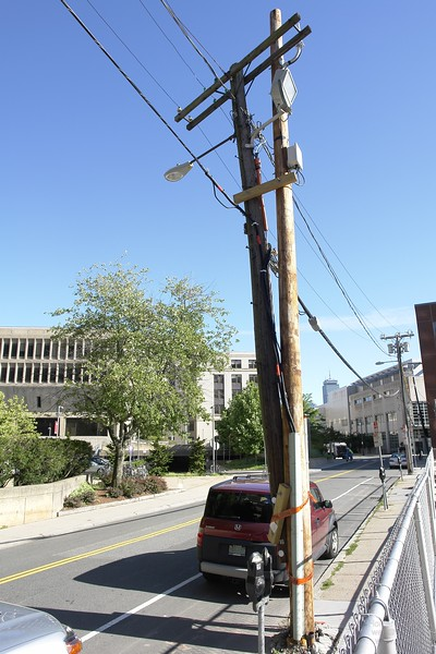 """Never change a running system!"" - MIT Building in the background. ""hotfixed"" utility pole"