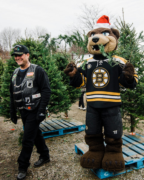 Scott Cloutier greets mascot Blades as the Boston Bruins Foundation was on hand to give out free Christmas trees to veterans at the Gardner's Spot in Leominster on Friday, December 8, 2017. SENTINEL & ENTERPRISE / Ashley Green