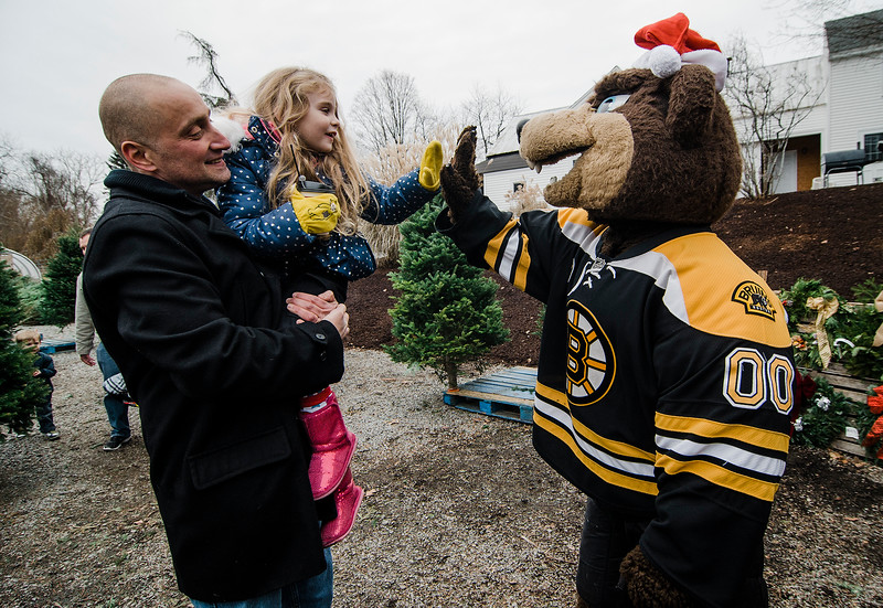 Joe Firmani and Jennifer Firmani greet mascot Blades as the Boston Bruins Foundation helped in giving out free Christmas trees to veterans at the Gardner's Spot in Leominster on Friday, December 8, 2017. SENTINEL & ENTERPRISE / Ashley Green