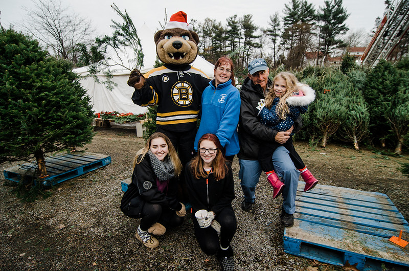 Skylar Boisvert, Jackie Firmani, Lisa Boisvert, Joe Firmani, Sr. and Jennifer Firmani grees mascot Blades as the Boston Bruins Foundation was on hand to give out free Christmas trees to veterans at the Gardner's Spot in Leominster on Friday, December 8, 2017. SENTINEL & ENTERPRISE / Ashley Green