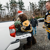 Dave Babineau, U.S. Air Force veteran with the Wounder Warriors Project, picks up his free Christmas tree with the help of Boston Bruins mascot Blades and former player Bob Sweeney at the Gardner's Spot in Leominster on Friday, December 8, 2017. SENTINEL & ENTERPRISE / Ashley Green