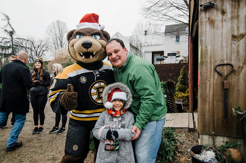 Skyla and Sam Campbell greet mascot Blades as the Boston Bruins Foundation helped in giving out free Christmas trees to veterans at the Gardner's Spot in Leominster on Friday, December 8, 2017. SENTINEL & ENTERPRISE / Ashley Green