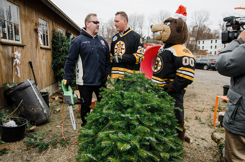 Formers Bruins players Lyndon Byers and Bob Sweeney join mascot Blades as the Boston Bruins Foundation helped in giving out free Christmas trees to veterans at the Gardner's Spot in Leominster on Friday, December 8, 2017. SENTINEL & ENTERPRISE / Ashley Green