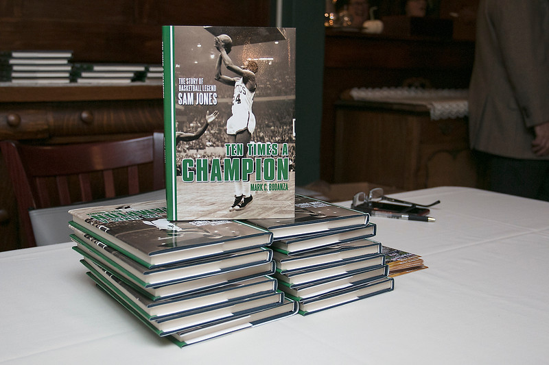 Boston Celtics legend Sam Jones told some stories at Apple Hill Farm and Country Club in Leominster on Thursday night and then sign the book about him by Leominster author Mark Bodanza. SENTINEL & ENTERPRISE/JOHN LOVE