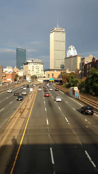 Time lapse photo shot from the Charlesgate Overpass, showing the Mass Pike approaching the City of Boston.