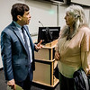Gail Hoar speaks with Boston Globe Spotlight reporter Mike Rezendes following the 'The Power of Journalism in a Perilous Age' discussion at Fitchburg State University on Wednesday, April 12, 2017. SENTINEL & ENTERPRISE / Ashley Green