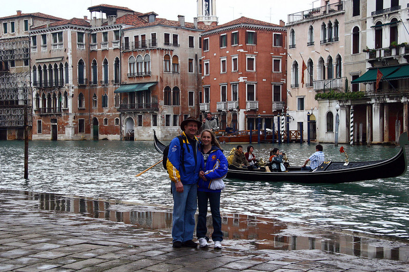 Nikki and Doug in Venice as the canal slips in onto the sidewalk.
