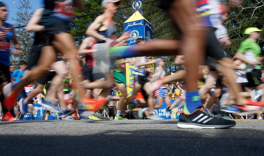 . Runners in the first wave cross the line at the start of the 2017 Boston Marathon in Hopkinton, Mass., Monday, April 17, 2017. (AP Photo/Mary Schwalm)