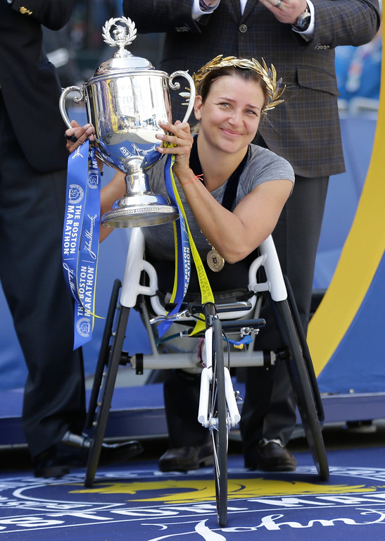 . Manuela Schar, of Switzerland, holds the trophy after winning the women\'s wheelchair division of the 121st Boston Marathon on Monday, April 17, 2017, in Boston. (AP Photo/Charles Krupa)