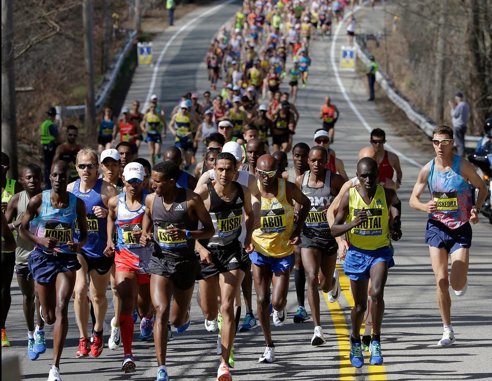 . Yemane Tsegay, of Ethiopia, fourth from left, leads the pack of elite men runners along the course of the 121st Boston Marathon on Monday, April 17, 2017, in Hopkinton, Mass. (AP Photo/Steven Senne)