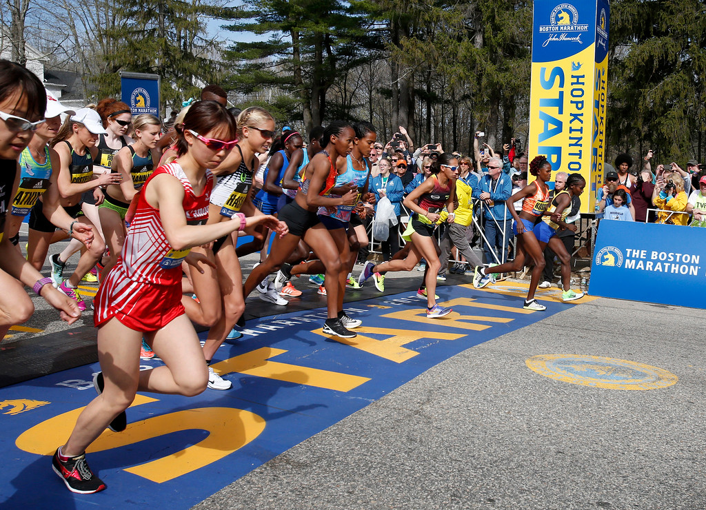. The elite female runners break from the starting line in the 2017 Boston Marathon in Hopkinton, Mass., Monday, April 17, 2017. (AP Photo/Mary Schwalm)