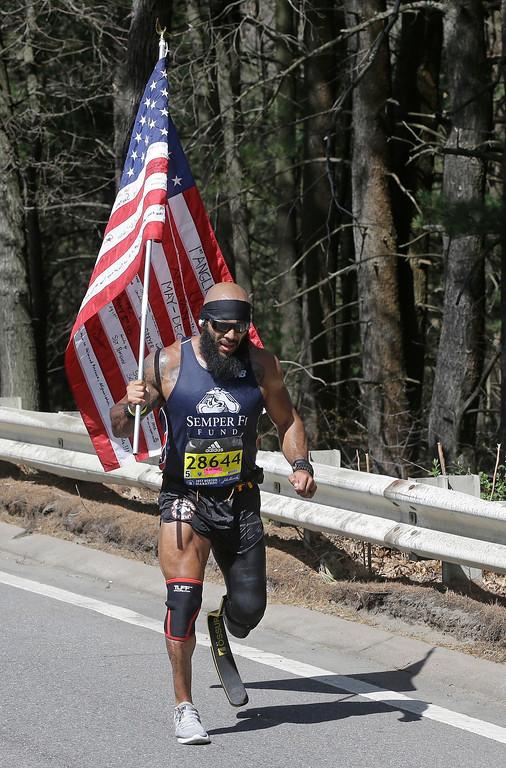 . Jose Sanchez, of the United States, runs along the course of the 121st Boston Marathon on Monday, April 17, 2017, in Wellesley, Mass. (AP Photo/Steven Senne)