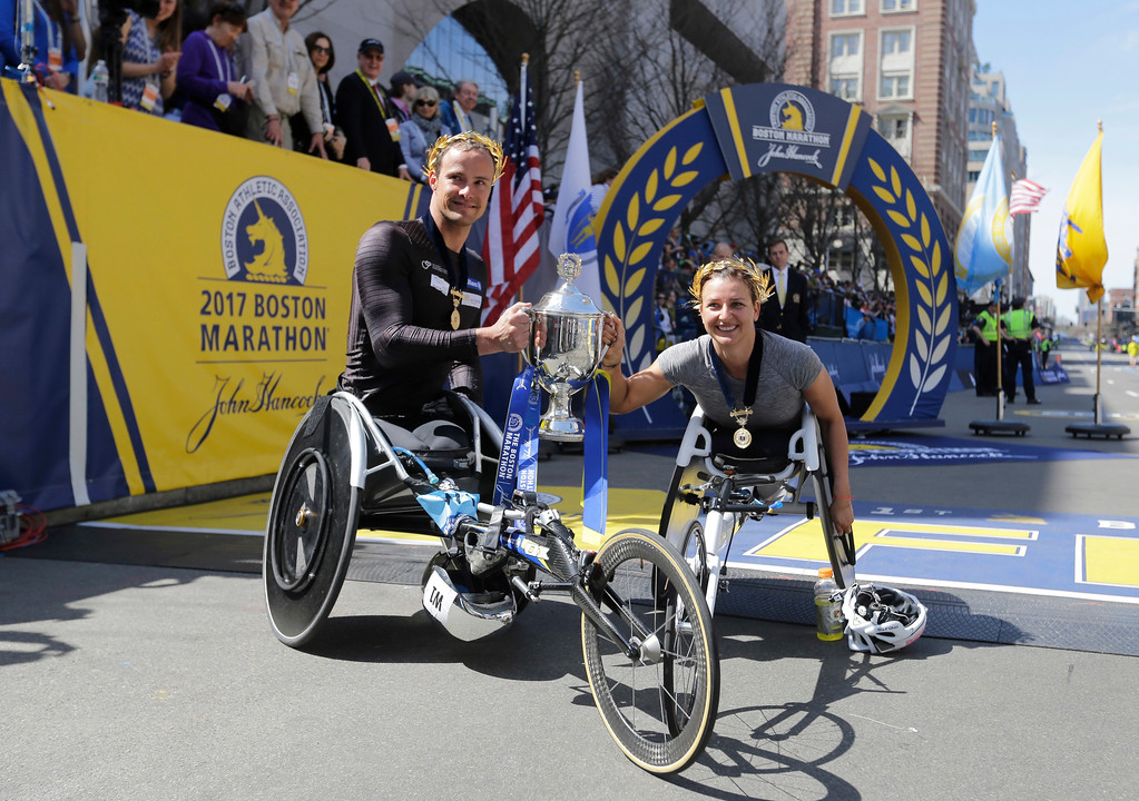 . Wheelchair division winners Manuela Schar, right, and Marcel Hug, both of Switzerland, pose after their wins in the 121st Boston Marathon women\'s and men\'s wheelchair divisions on Monday, April 17, 2017, in Boston. (AP Photo/Elise Amendola)