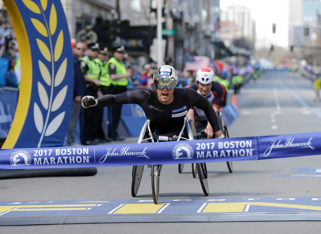 . Marcel Hug, of Switzerland, wins the men\'s wheelchair division ahead of Ernst Van Dyk, of South Africa, in the 121st Boston Marathon on Monday, April 17, 2017, in Boston. (AP Photo/Elise Amendola)