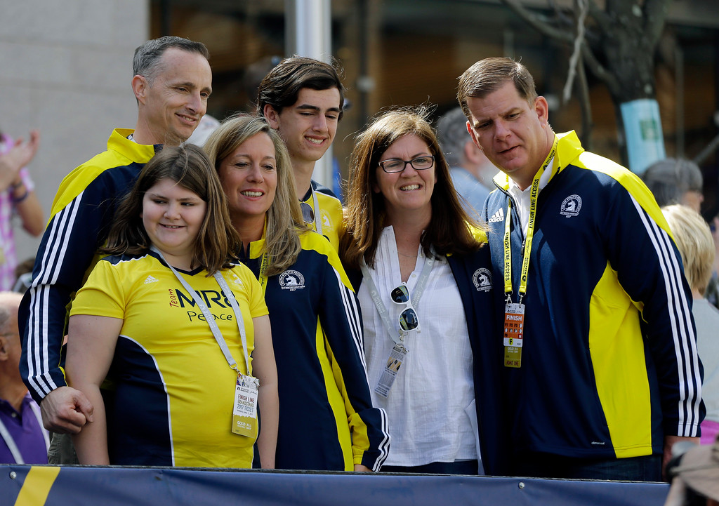 . Boston Mayor Marty Walsh, right, stands with the family of Martin Richard, one of the 2013 Boston Marathon bombing victims, near the finish line of the 121st Boston Marathon on Monday, April 17, 2017, in Boston. (AP Photo/Elise Amendola)