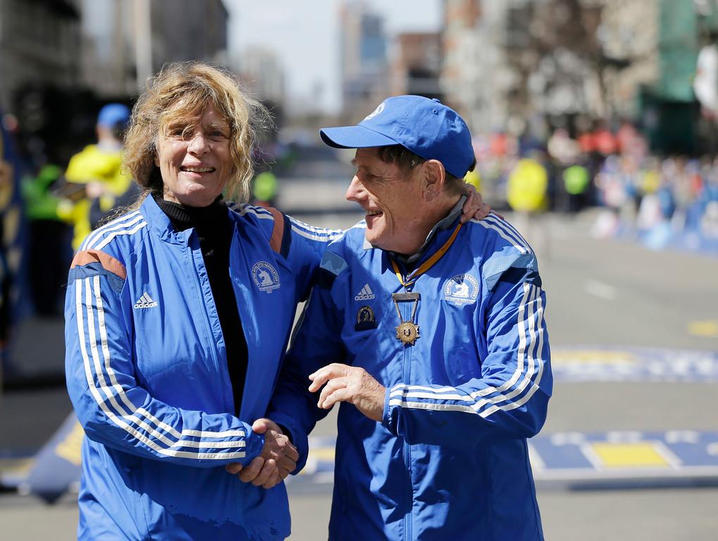 . Grand Marshals Bobbi Gibb, left, of the United States, and Dave McKenzie, of New Zealand, hug at the finish line during 121st Boston Marathon on Monday, April 17, 2017, in Boston. (AP Photo/Elise Amendola)