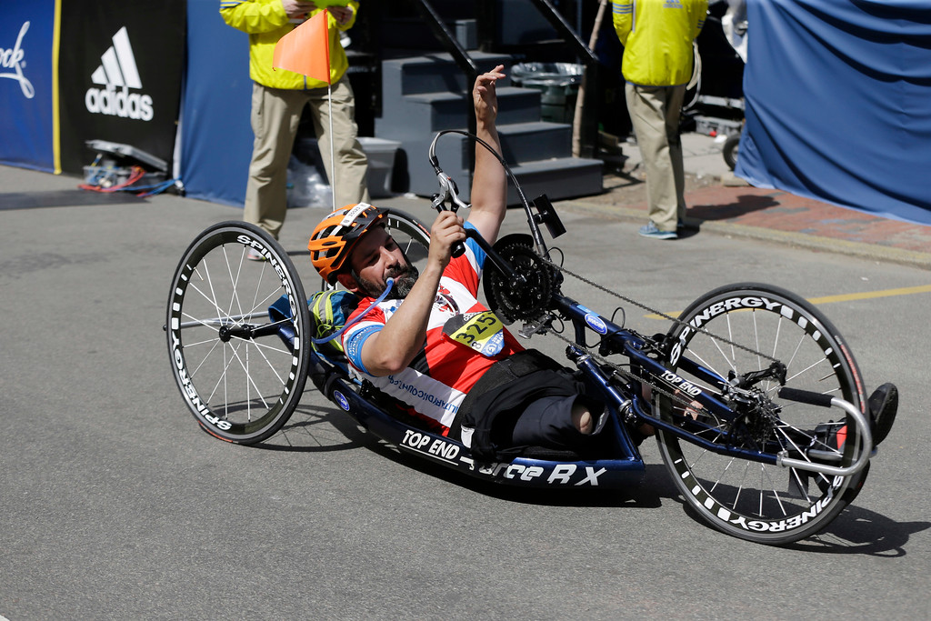 . Marc Fucarile, of Reading, Mass., gestures after crossing the finish line in the men\'s handcycle division of the 121st Boston Marathon on Monday, April 17, 2017, in Boston. Fucarile lost a leg in the 2013 Boston Marathon bombing. (AP Photo/Elise Amendola)
