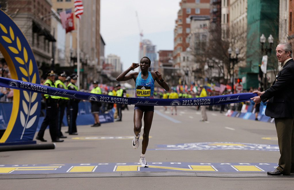 . Edna Kiplagat, of Kenya, approaches the finish line enroute to winning the women\'s division of the 121st Boston Marathon on Monday, April 17, 2017, in Boston. (AP Photo/Charles Krupa)