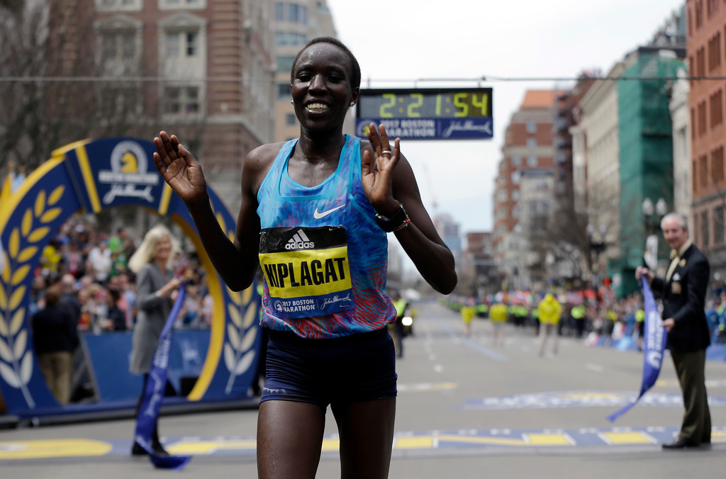 . Edna Kiplagat, of Kenya, gestures after winning the women\'s division of the 121st Boston Marathon on Monday, April 17, 2017, in Boston. (AP Photo/Elise Amendola)