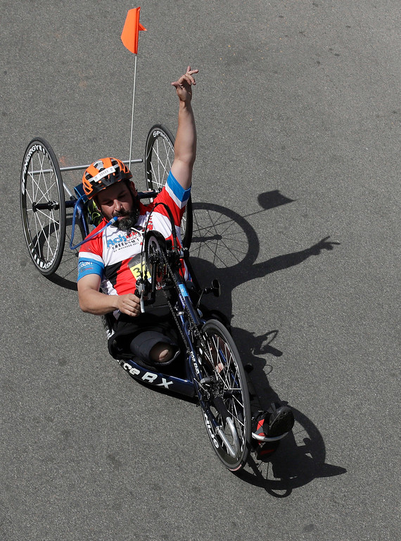 . Marc Fucarile, of Reading, Mass., gestures after crossing the finish line in the men\'s handcycle division of the 121st Boston Marathon on Monday, April 17, 2017, in Boston. Fucarile lost a leg in the 2013 Boston Marathon bombing. (AP Photo/Charles Krupa)