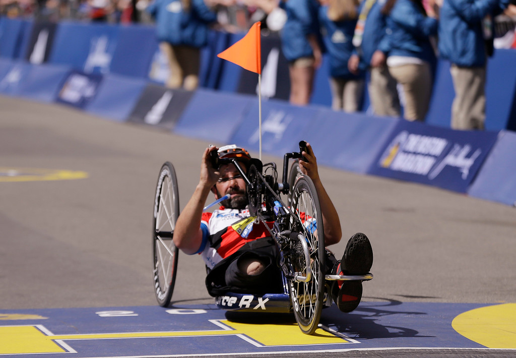 . Marc Fucarile, of Reading, Mass., crosses the finish line in the men\'s handcycle division of the 121st Boston Marathon on Monday, April 17, 2017, in Boston. Fucarile lost a leg in the 2013 Boston Marathon bombing. (AP Photo/Elise Amendola)