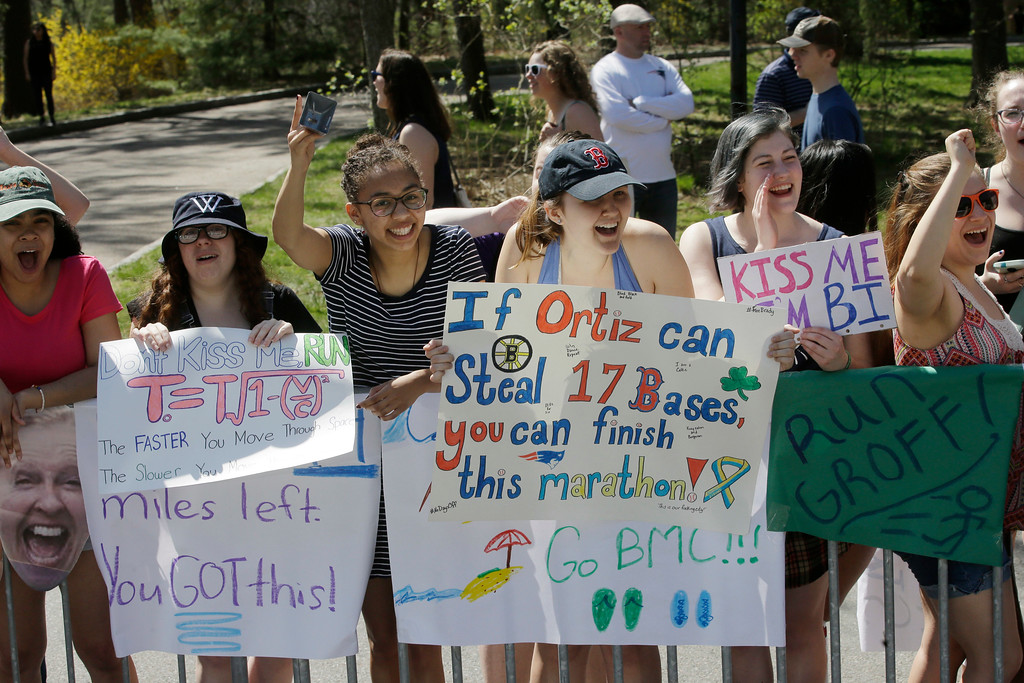 . Spectators cheer runners along the course of the 121st Boston Marathon on Monday, April 17, 2017, in Wellesley, Mass. (AP Photo/Steven Senne)