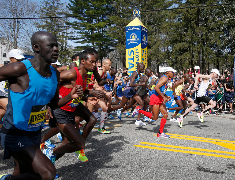 . Galen Rupp, far right, leads the men\'s elite runners as they break from the line at the start of the 2017 Boston Marathon in Hopkinton, Mass., Monday, April 17, 2017. (AP Photo/Mary Schwalm)