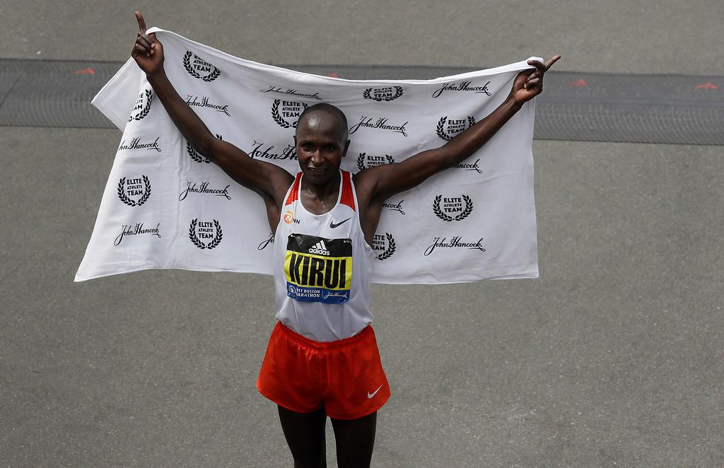 . Geoffrey Kirui, of Kenya, poses for photographers after winning the 121st Boston Marathon on Monday, April 17, 2017, in Boston. (AP Photo/Charles Krupa)