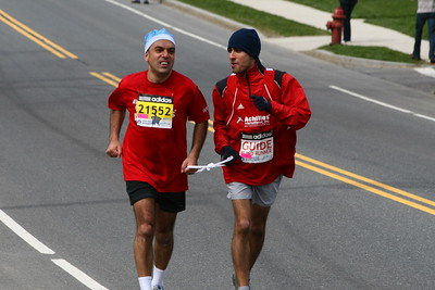A Blind runner is escorted on the course