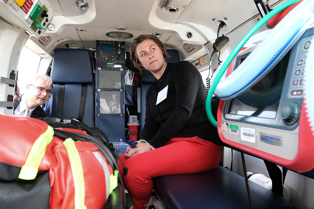 . Brooke Melia with Aisling Partners Insurance Brokerage LLC> got to see the inside of on of the Boston Med Flights helicopters after the ground breaking ceremony on Wednesday morning at Hanscom Field, Bedford. On June 7, 2017 Boston Med Flight held a ground breaking ceremony for a new headquarters and Critical Care Transport Operations Facility at Hanscom. SUN/JOHN LOVE