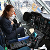 Malisa Schuyler with Tuffs Medical Center and a Boston Med Flight ( BMF) board member sits in the cockpit of one of their helicopters as she learns about it from BMF RN/EMT Kathy Moynihan after the ground breaking ceremony on Wednesday morning at Hanscom Field, Bedford. On June 7, 2017 Boston Med Flight held a ground breaking ceremony for a new headquarters and Critical Care Transport Operations Facility at Hanscom. SUN/JOHN LOVE