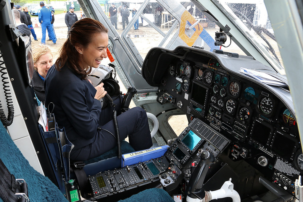 . Malisa Schuyler with Tuffs Medical Center and a Boston Med Flight ( BMF) board member sits in the cockpit of one of their helicopters as she learns about it from BMF RN/EMT Kathy Moynihan after the ground breaking ceremony on Wednesday morning at Hanscom Field, Bedford. On June 7, 2017 Boston Med Flight held a ground breaking ceremony for a new headquarters and Critical Care Transport Operations Facility at Hanscom. SUN/JOHN LOVE