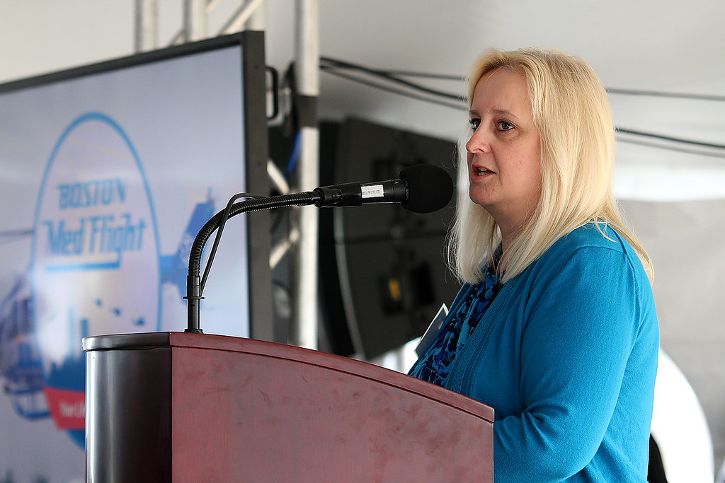 . Boston Med Flight CEO Maura Hughes addresses the crowd at the ground breaking ceremony on Wednesday morning at Hanscom Field, Bedford. On June 7, 2017 Boston Med Flight held a ground breaking ceremony for a new headquarters and Critical Care Transport Operations Facility at Hanscom. SUN/JOHN LOVE