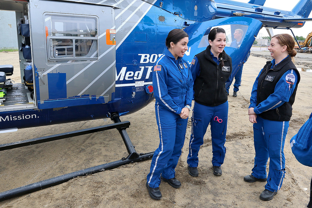 . RN\'s with Boston Med Flight, from left, Juliana Lavopa, KatelinMaguire and Beth Mee chat as they wait for people to ask about their helicopter after the ground breaking ceremony on Wednesday morning, June 7, 2017. BMF held a ground breaking ceremony for a new headquarters and Critical Care Transport Operations Facility at Hanscom Field, Bedford. SUN/JOHN LOVE