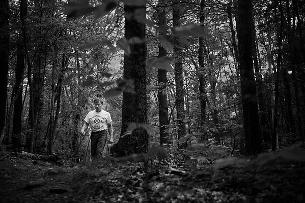 Devio walks along a path by his house in Hopkinton, Mass.