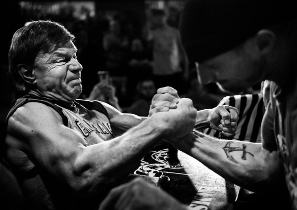 Devio pins an opponent in the 2nd round of the Maine State Championship arm wrestling tournament in South Portland, Maine.