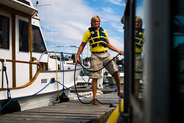 Philip Aldridge, director of operations, of Sea Machines Robotics docks the 'Steadfast' autonomous boat in the Boston Harbor Shipyard & Marina on August 23, 2017 in Boston, Massachusetts. For Bloomberg Businessweek.
