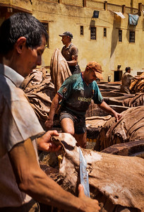 Workers trim hides at the Chouara tannery in the Medina in Fes, Morocco.