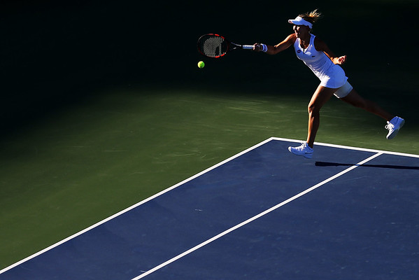 Elena Vesnina of Russia returns a shot during her match against Annett Kontaveit of Estonia on day 3 of the Connecticut Open at the Connecticut Tennis Center at Yale on August 23, 2016 in New Haven, Connecticut.