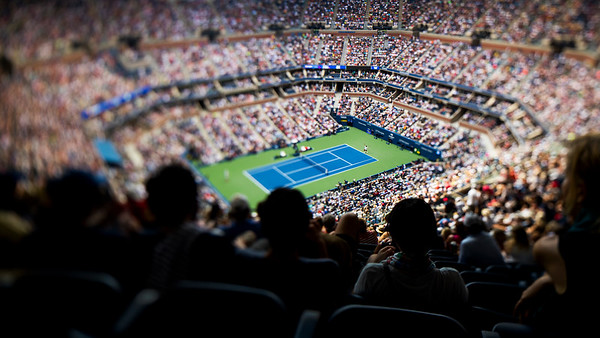 Roger Federer of Switzerland serves against BenoitPaire of France in the Men's Singles round two match on Arthur Ashe Stadium at the 2018 US Open Tennis Tournament at the USTA Billie Jean King National Tennis Center on August 30th, 2018 in Flushing, Queens, New York City.