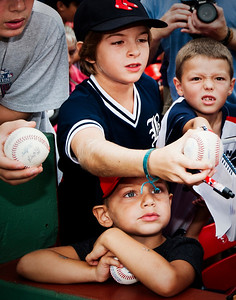 Kids reach for autographs before the Boston Red Sox take on the Kansas City Royals at Fenway Park on August 23, 2015 in Boston, Massachusetts.