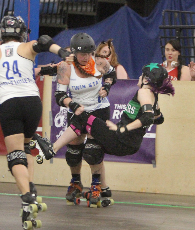 """. Boston Roller Derby at Shriners Auditorium. Bay State Punishers (black) vs Twin State Vixens (white). Punishers\' Allison Balik (24, \""""Glutenless Maximus\"""") of Somerville, formerly of Lowell, right, is knocked down by Vixens\' Pumpkin Carvher (13). (SUN/Julia Malakie)"""